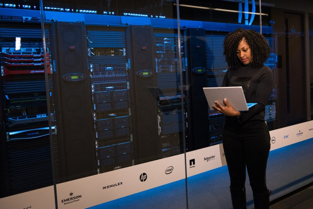 Woman in a datacentre planning a migration